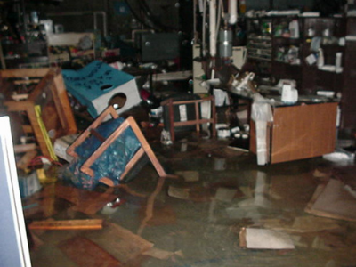 photo of offices flooded with chairs floating in the water