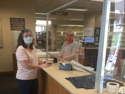 photo of two library workers with masks on